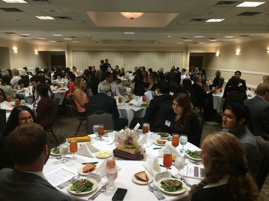 More than 100 students attended the sold-out business etiquette dinner Oct. 18 hosted by the Career Management Center and the Dillard College of Business Administration. Photo by Ethan Metcalf.