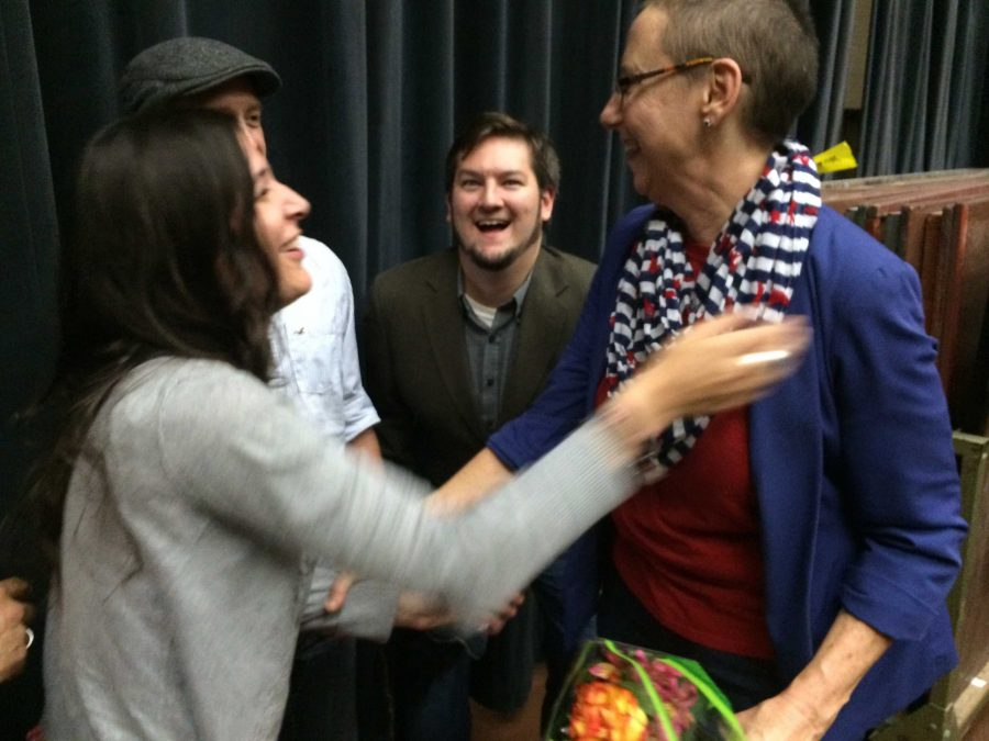 Theater graduates Brette Rector, Chris Rector and Time Doyle congratulate Laura Jefferson, associate theater professor, after the Oct. 11 announcement of the Laura Jefferson Acting Scholarship. Photo by Ethan Metcalf