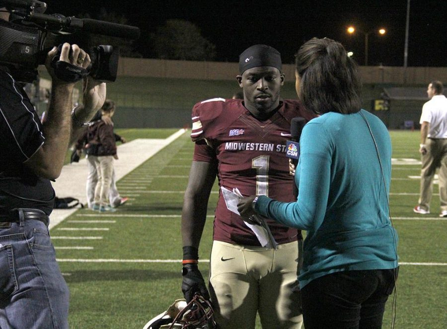 Keidrick Jackson, criminal justice alumni, is interviewed after the Texas A&M-Kingsville game October 5, 2013 at memorial stadium against Texas A&M-Kingsville. MSU won 43-10.