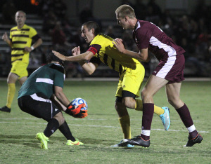 Kalen Ryden, mass communication senior, is pushed while trying to defend Saturday at the match against West Texas A&M University at the soccer field. After two overtimes MSU won 3-2. Photo by Lauren Roberts