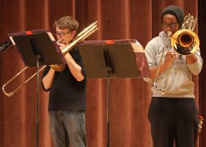 "Austin Glenn, music education freshman, and Makayla Scott, music education freshman, practice at The Bone Yard Jazz Trombone Ensemble rehearsal for An Evening of Jazz and Pop Music Tuesday afternoon. The performance was in Akin Auditorium Nov. 18. Makayla Scott, music education freshman, said, ""If you want to hear rock and jazz performed for free come and listen."" Photo by Lauren Roberts"