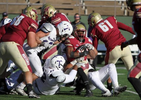 Dante Taylor, kinesiology sophomore, is tackled in the game between Midwestern State University and Tarleton State University Saturday Nov. 15, 2014 at Memorial Stadium. Photo by Lauren Roberts