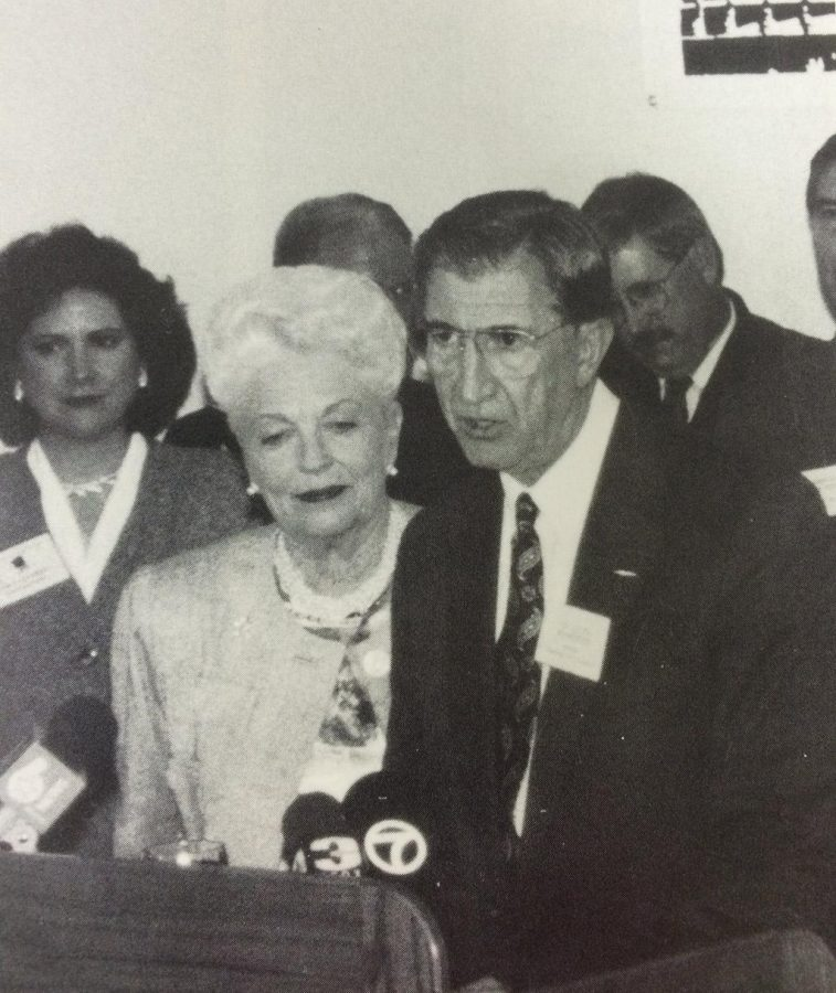 """During """"Capital for a Day,"""" Louis Rodriguez introduces Governor Ann Richards and her cabinet to the media, faculty and students in the Clark Lounge. Source: Wai-Kun, 1995. Photo by Drew Myers."""