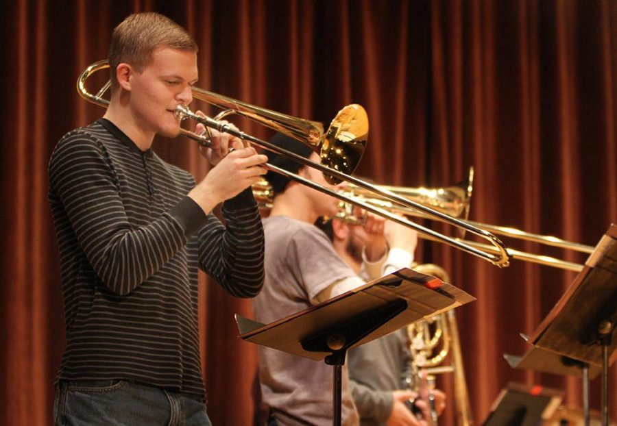 Jared Pruett, music education freshman, and Adam McGee, music education freshman, practice with The Bone Yard Jazz Trombone Ensemble rehearsal for An Evening of Jazz and Pop Music Tuesday afternoon. The performance was in Akin Auditorium Nov. 18. Makayla Scott, music education freshman, said, If you want to hear rock and jazz performed for free come and listen. Photo by Lauren Roberts