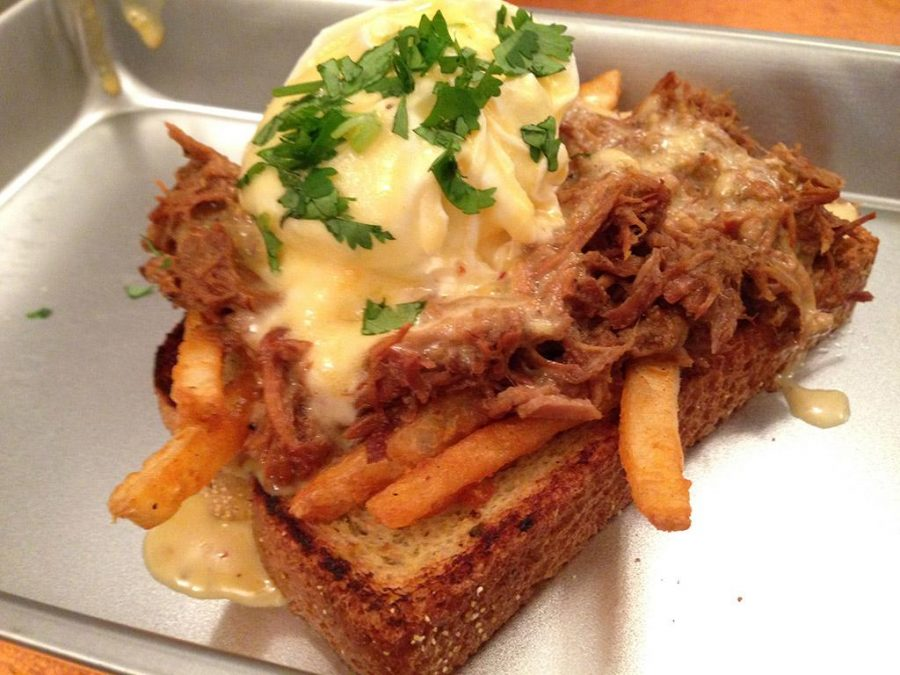 The Texas Benny: Jalapeño toast topped with fries, Dr Pepper pulled pork, poached egg and hollandaise sauce.