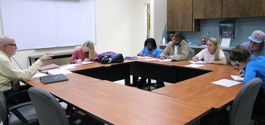 Bob Brotherton, sitting judge in Wichita Falls' 30th District Court, leads a study session for a Criminal Justice class on November 10th at 6 pm in the Martin Building. Photo by Rachel Johnson