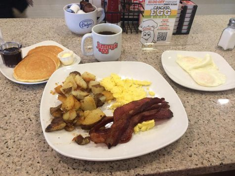 Jimmy's Egg's traditional breakfast: bacon, home fries, three pancakes and two eggs made to order.