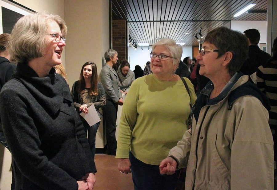 Ann Hunter, continued education MSU student, and Cynthia Procknow, continued education MSU student, congratulate Dornith Doherty on her works from
