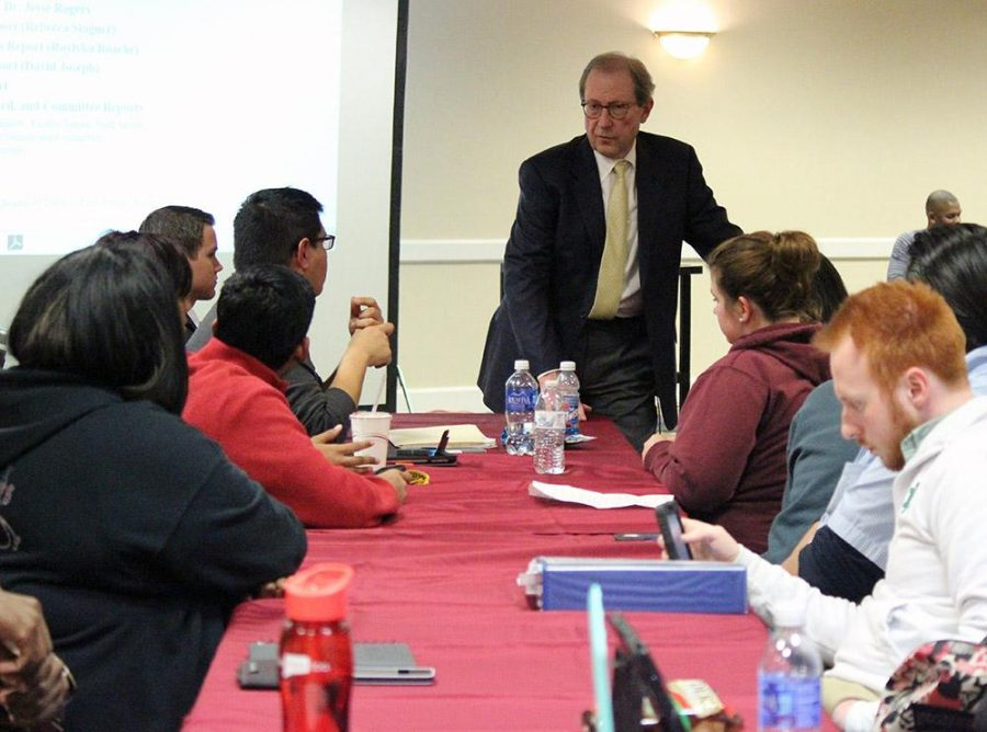 Jesse Rogers, president of Midwestern State, answers Marco Torres, senior class senator, question about future parking plans for fall of next year during the Student Government Association meeting on February 3, where close to 70 students were in attendance. Photo by Rachel Johnson