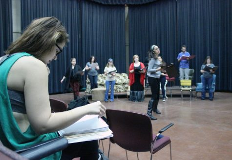 Leanne Ottaviano, theater acting/directing senior, helps direct the cast as they have their first rehearsal all together for blocking on Sunday morning, Feb. 1, for the play, 'The Vagina Monologues.' Photo by Rachel Johnson