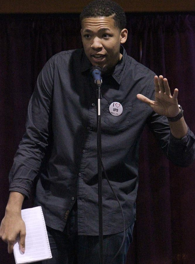 Brett Lincoln, mass communication junior, performs two poem at the UPB Poetry Night, featuring ODD?ROD, held in the Atrium of the Clark Student Center on Thursday Feb. 26, 2015. Over 100 students were in attendance for this Balck History Month event. Photo by Rachel Johnson