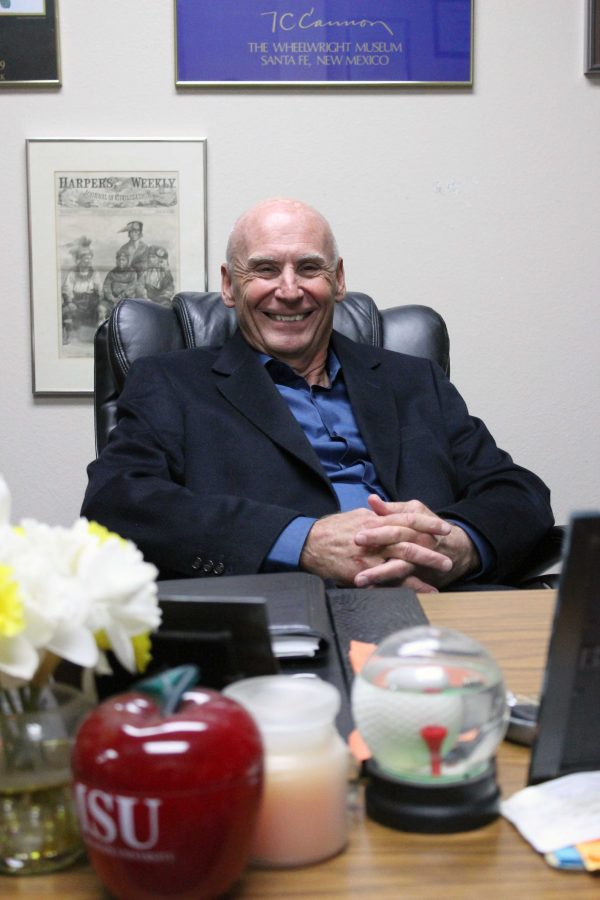 Larry Williams in his office in Bea Wood Hall. Williams has been at the helm of the study abroad program for about 30 years. Photo by Rachel Johnson.