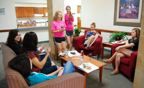 Resident assistants Kelsie Allen, sophomore in nursing, Ashley Minx, senior in social work, Mae Johnson, sophomore in nursing, Ashley Brown, senior in nursing, Kimberly Nowell, senior in education, and ­Rebecca Stogner, sociology junior, get together and prepare for the fall semester Aug. 16, 2013. File photo by Hanwool Lee.