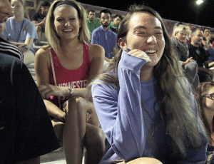 Kylie Austin, history freshman, laughs with friends at the men's soccer match between Midwestern State University and Eastern New Mexico Monday, Oct. 27, 2014 at the soccer field. Photo by Lauren Roberts