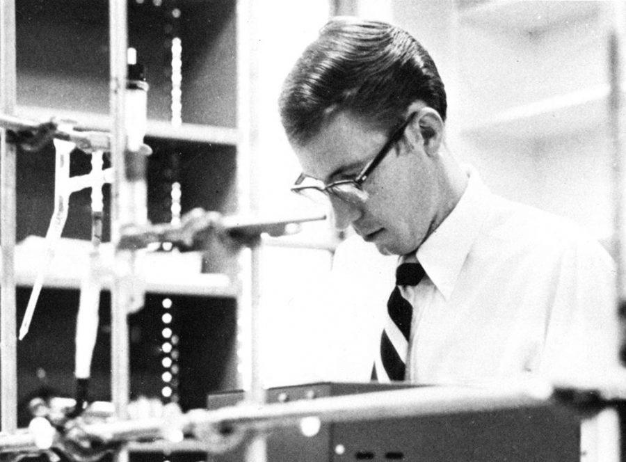 Professor Jesse Wallace Rogers works in the chemistry lab. Photo courtesy Waikun 1972.