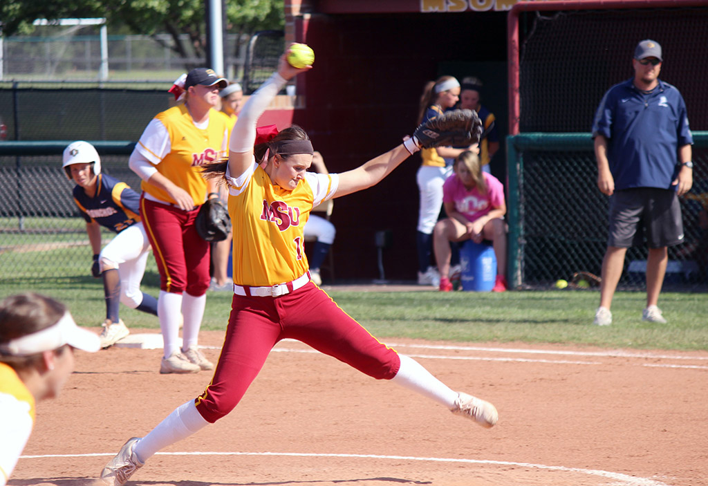 Katlyn Holmes, undecided sophomore, pitches during the MSU vs. Central Oklahoma game in Mustangs Park. The Mustangs lost with the final score 18-5. Tuesday, April 21, 2015. Photo taken by Francisco Martinez.