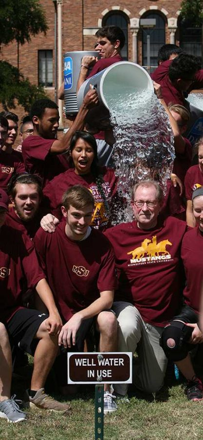 University President Jesse Rogers gets water dumped on him in an effort to raise money for Lou Gehrig's disease. Rogers took the challenge from officials at West Texas A&M and passed the challenge along to Angelo State University. Photo by Bradley Wilson.