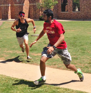 "Danny Le, nursing sophomore and the ""O-Z"" zombie, chases Thomas Mammen, biology pre-med freshman, as part of the Humans vs. Zombies game. Photo by Avery Whaite."
