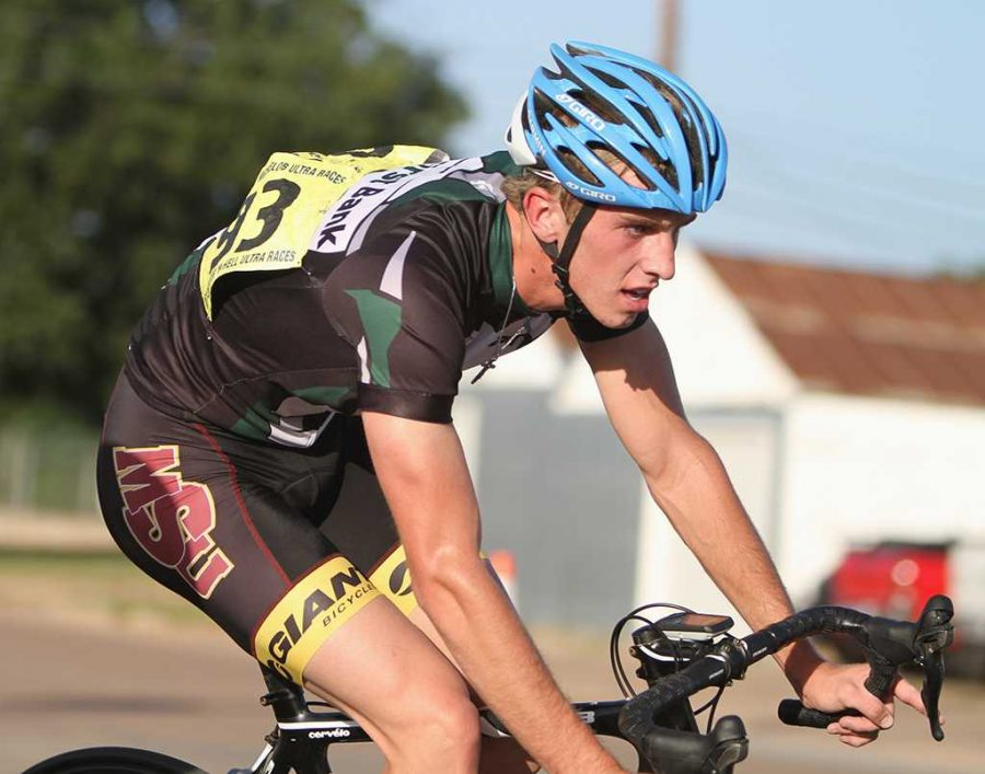 Luke Allen, freshman in political science, rides in the 2014 Hotter N Hell mens crit race.