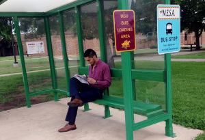 Nik Bolig, political science sophomore waits for the bus on April 28, 2015. He said the Saturday route would be more successful if they ran the normal route and times along with MESA route. Photo by Morgan Haire.