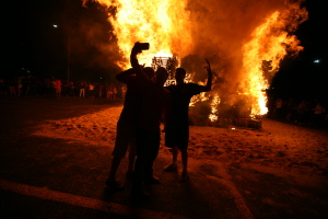 A group of students takes a selfie at the homecoming bonfire, Oct. 23, 2014.
