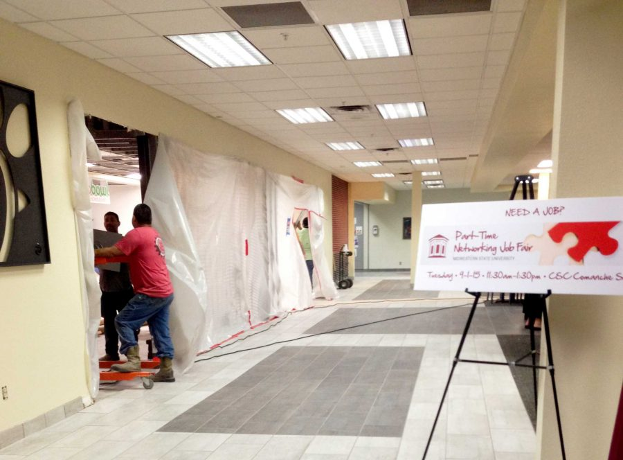 Workers put the final touches on the remodeled food court in the Clark Student Center on Aug. 12. Photo by Morgan Haire.
