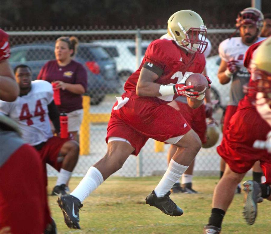 Linebacker, Lafrontae Conkleton, business junior, runs the ball down the field trying to get past his teammates in a drill during practice, Monday August 24, 2015. Photo by Francisco Martinez