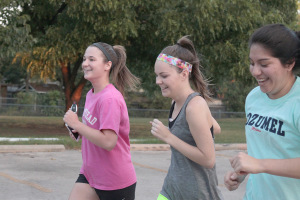 Amy Melholland, marketing junior, Taylor Sikes.sociology senior, and Sandra Alonzo, nursing senior, running together on their first lap of the Superhero 5K around the Sikes Lake trail on Sept. 28. Photo by Kayla White.