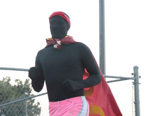 "Ian ""The Stang Man""  Thompson, special education junior, running in his black morphsuit with the MSU flag tied around his neck at the Superhero 5K around the Sikes Lake trail on Sept. 28. Photo by Kayla White."