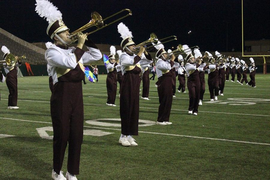 The Golden Thunder Band does a special tribute to the band Queen as their second performance in their first halftime show of the season at Memorial Stadium, Sept. 5. Photo by Rachel Johnson