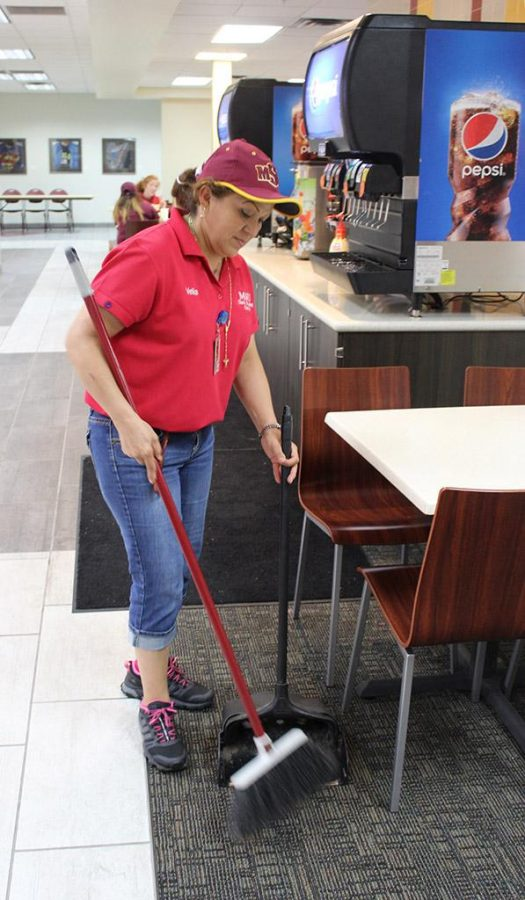 Velia Lozano, custodian in the Clark Student Center, sweeps the food court in the Mesquite Dining Hall on Sept. 22. Photo by Gabriella Solis