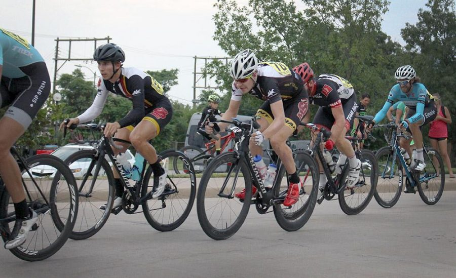 Cyclists Joshua Buchel, accounting freshman, and Cameron Lowery, nursing junior,  race in the crit race of the Hotter'N Hell on Aug. 28, 2015. Photo by Kayla White