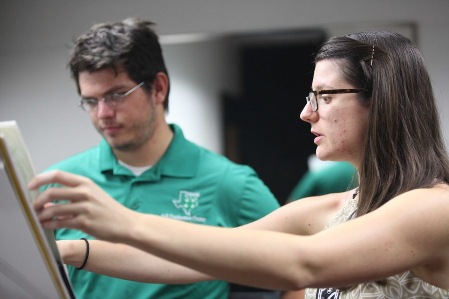 Hana Beloglavec, visiting instructor and international award-winning trombonist, helps James Ivey, music and mechanical engineer senior, in a private lesson, Sept. 9 . Photo by Rachel Johnson