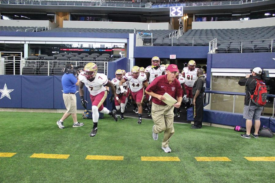 Head football coach Bill Maskill leads the football team onto the field of AT&T Stadium for the start of the game, Sept. 19. MSU defeated Eastern New Mexico University, 28-24. Photo by Rachel Johnson