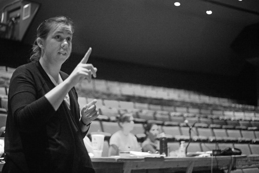 Karen Dabney, theatre director, gives notes to the cast during rehearsal on Sept. 22. Photo by Gabriella Solis.