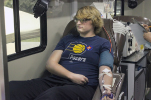 Jacob Spicer, nursing junior, donates blood at the MSU vs West Texas A&M blood drive completion in Jess Rogress memorial Oct 6. Photo by Francisco Martinez