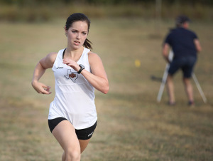 Angela Dees, kinesiology sophomore, finished strong after running at Midwestern State Invitational at Lake Wichita Park Oct, 8. Photo by Francisco Martinez