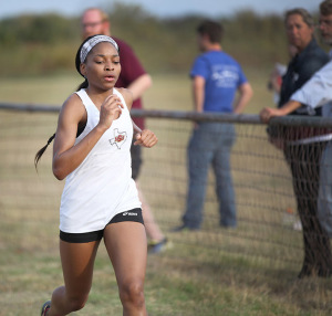 Jasmine Stokes, general studies junior, sprints toward the finish line in Midwestern State Invitational at Lake Wichita Park Oct, 8. Photo by Francisco Martinez