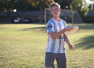 Mark Hill, management information systems sophomore, gets ready to throw the frisbee to his teammate during a warm-up before practice begins, Oct. 13, on the field across from the MSU soccer field. Photo by Gabriella Solis.