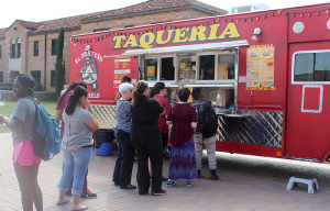 People wait in line to get tacos from El Norteno on Sept. 22 on Jesse Rogers Memorial Promenade. Photo by Gabriella Solis.