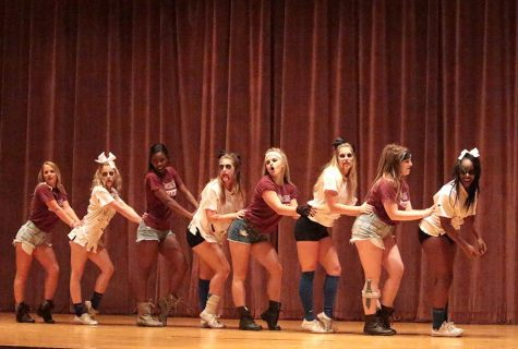 Cheerleaders perform at the Lip Sync competition held in Akin Auditorium on Oct. 27. Photo by Kayla White.
