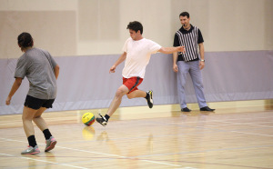 Drew Skinner, biology senior, attempts a shot at the goal in the recreational sports in the Wellness Center where TKE beat FC Mustangs 4-0, Oct. 13. Photo by Francisco Martinez