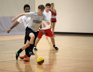 Zane Horton, criminal justice freshman receives a pass then avoids Drew Skinner, biology senior, and Manny Bhogal, marketing senior, at the recreational sports in the Wellness Center where TKE beat FC Mustangs 4-0, Oct. 13. Photo by Francisco Martinez