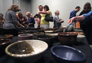 Attendees choose their bowl at the Empty Bowls event at the WIchita Falls Muesum of Art at MSU Tuesday afternoon. Photo by Lauren Roberts