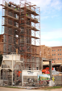 Construction of the new residence hall, located between three existing residence halls and the Fain Fine Arts building. The new hall is scheduled to open in 2016 and is substantially on schedule with electricity scheduled to be turned on during the winter break.