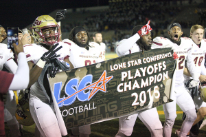 Derek Lockhart, sports and leisure senior, walks along the field with Brandon Gordon, education senior, and the team after winning the Lone Star Conference Championship, beating Texas A&M – Commerce 37-33 Nov. 14. Photo by Francisco Martinez