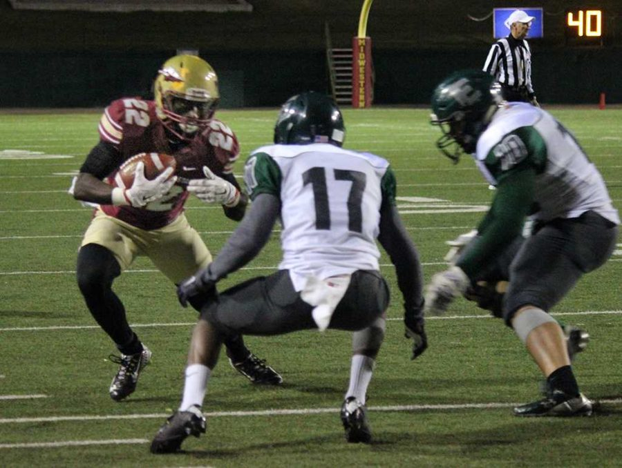 Don Jerry, psychology sophomore, attempts to run past the Eastern New Mexico University players during the play off game, Nov. 7, held in Memorial Stadium. During the previous weeks game, Jerry was the LSC Special Teams Player of the Week. Photo by Rachel Johnson