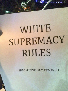 """This """"White Supremacy Rules"""" poster was posted on a car on campus along with 3 other posters similar to it with different hashtags. The other three hashtags included: #FUCKCAMPUSCLIMATE #WHITEPOWER #ONOURCAMPUS"""