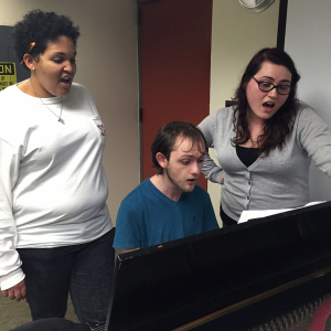 Whitney Hogue, vocal education junior, Matt Kohler, vocal education junior, and Alexis Goodman, vocal performance senior, practice one of the pieces for the upcoming Dec. 6 concert. Photo by Yvette Ordonez.