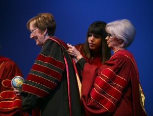Megan Piehler and Nancy Marks, members of the Board of Regents, put the ceremonial hood on Suzanne Shipley, university president, Midwestern State University, Dec. 11, 2015. Photo by Bradley Wilson